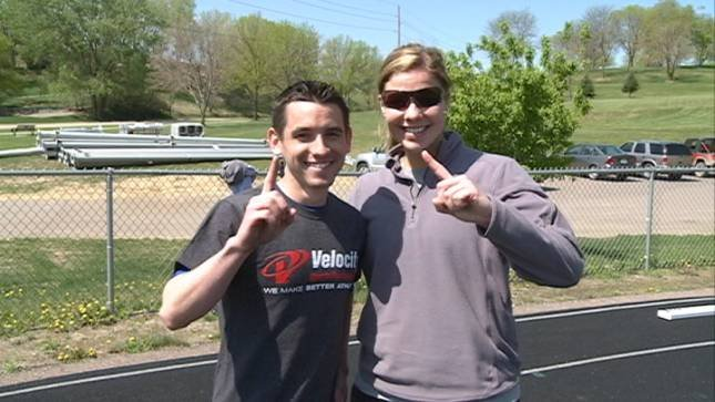 KTIV's Nick Filipowski and North trainer Tedi Andrews give the #1 sign at Wednesday's combine training.