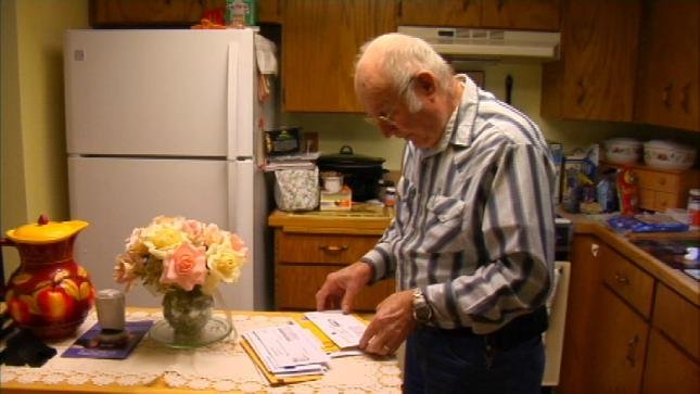Ray Gibbs lost thousands in foreign lottery scam.