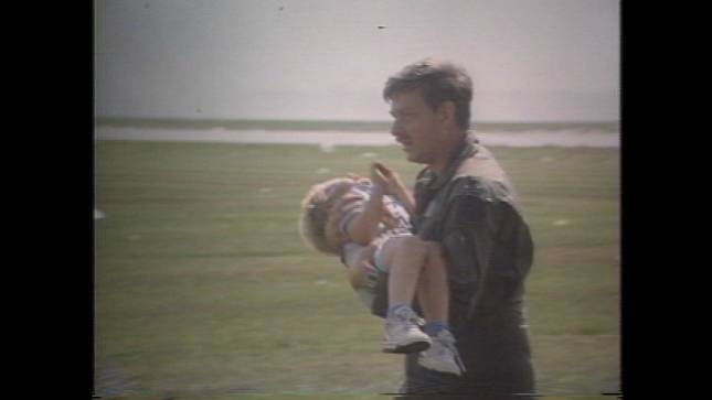File photo of Spencer Bailey being carried by Lt. Colonel Dennis Nelson after the United Flight 232 crash.