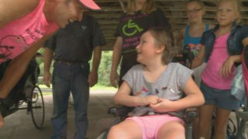 Shaun Evans tells six-year-old Eliza Bush about her new running chariot she received on Wednesday.
