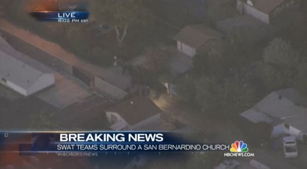 Police search neighborhoods for suspect in San Bernardino, California.