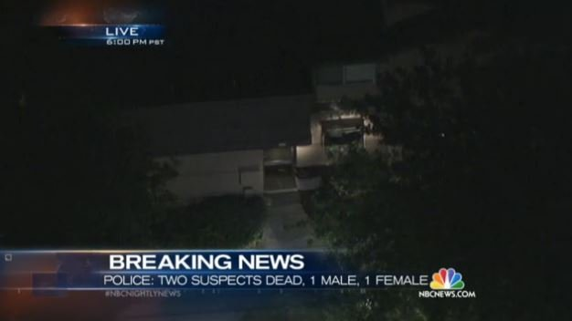 NBC photo of coverage at 8:02 p.m. on December 2, 2015: SWAT vehicle ramming home in Redlands, Calif., near San Bernardino.