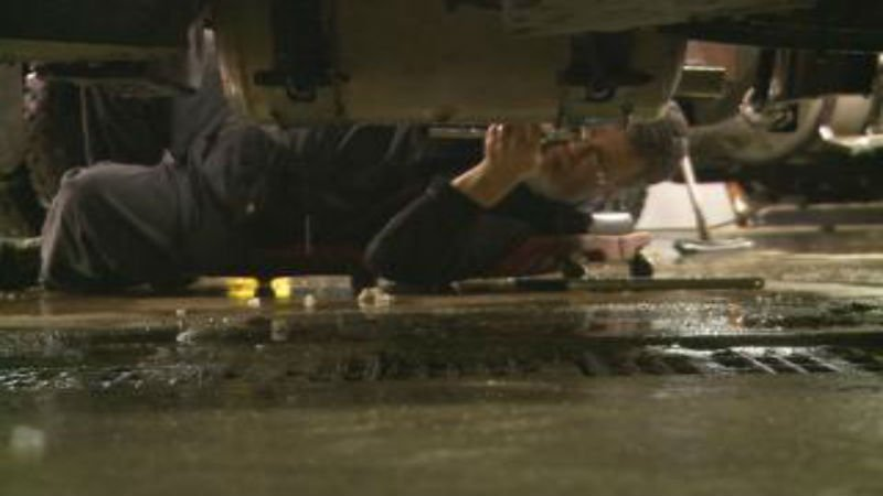 A Sioux City snow plow is worked on after pulling into a maintenance garage Wednesday evening.