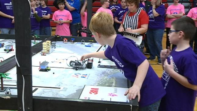 Teams compete for the champion title in first lego league for Champion motors waterloo iowa